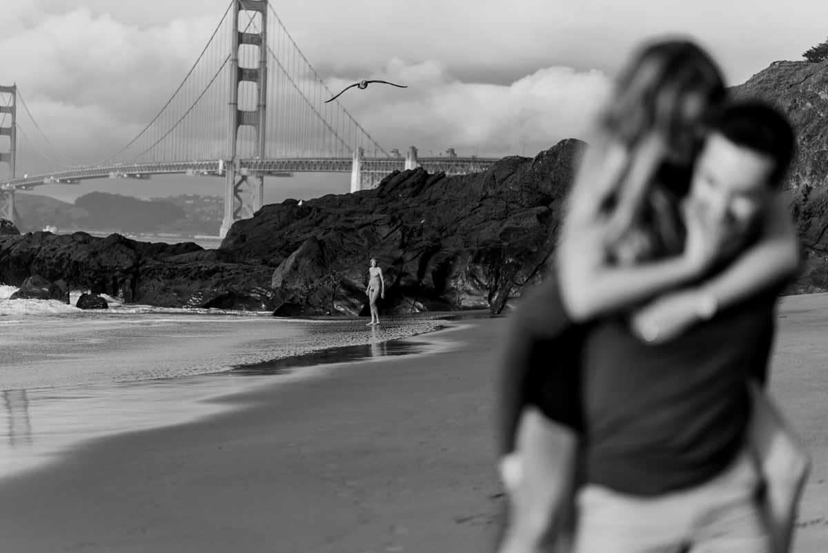 Baker Beach engagement photo with nude person