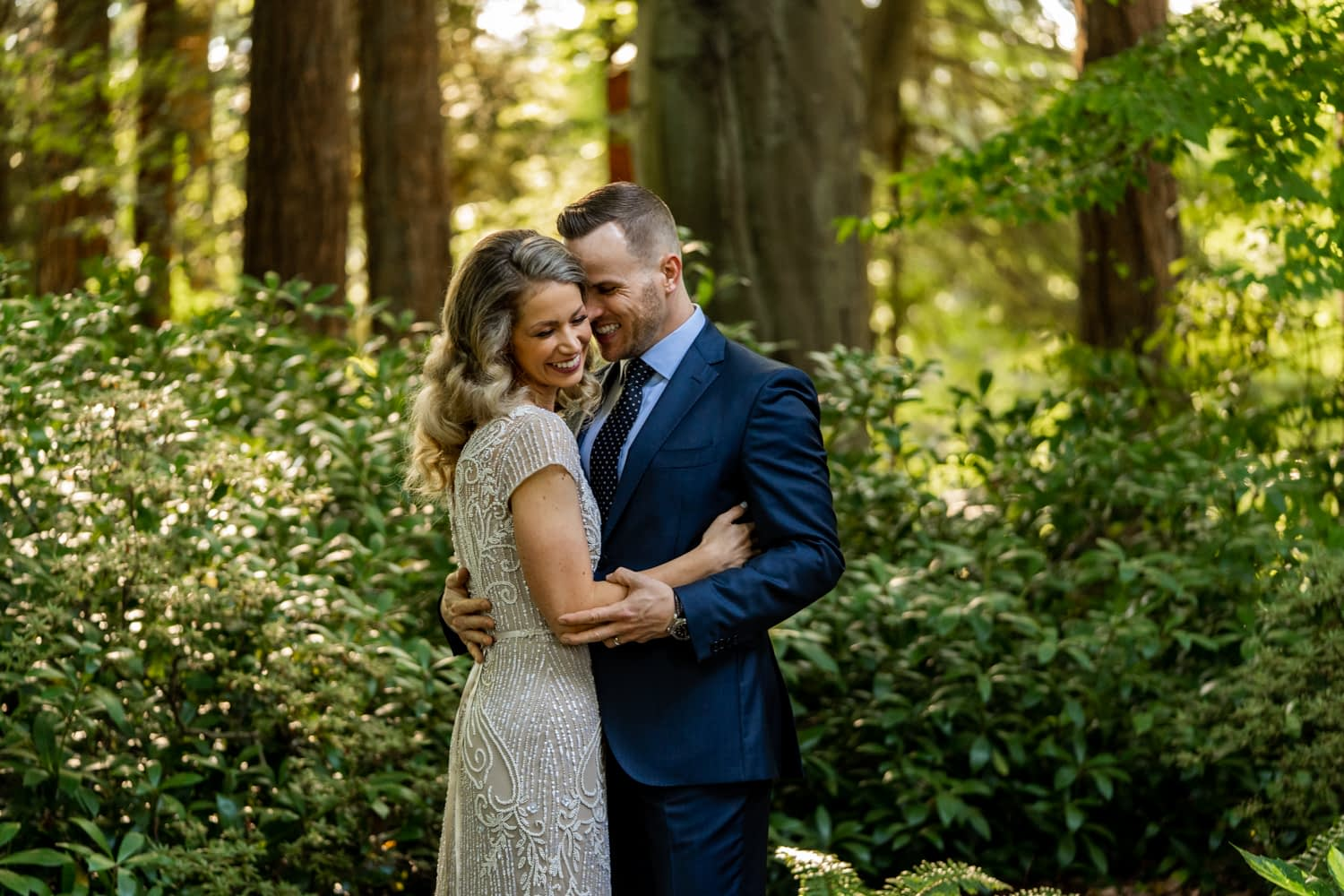 couple hugging at Stanley Park right after their elopement