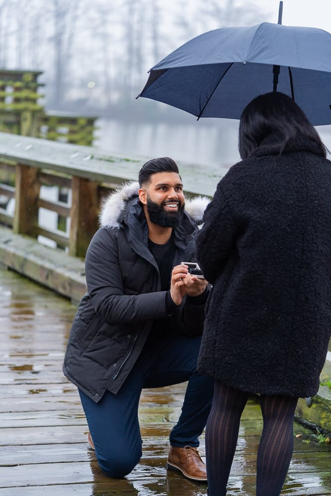 Boyfriend on one knee as he proposes to his girlfriend