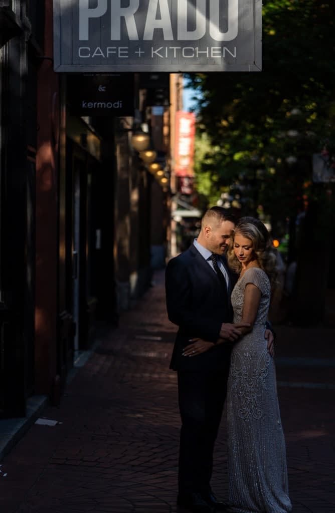 couple embracing each other in Gastown after their wedding