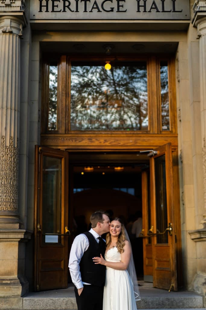 Groom and Bride in front of Heritage Hall on Main Street