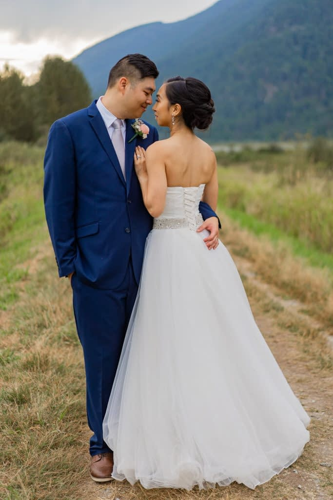 Intimate moment between groom and bride at Pitt Lake