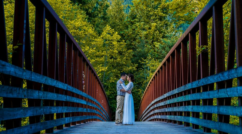 Furry Creek bridge and couple during their engagement portraits