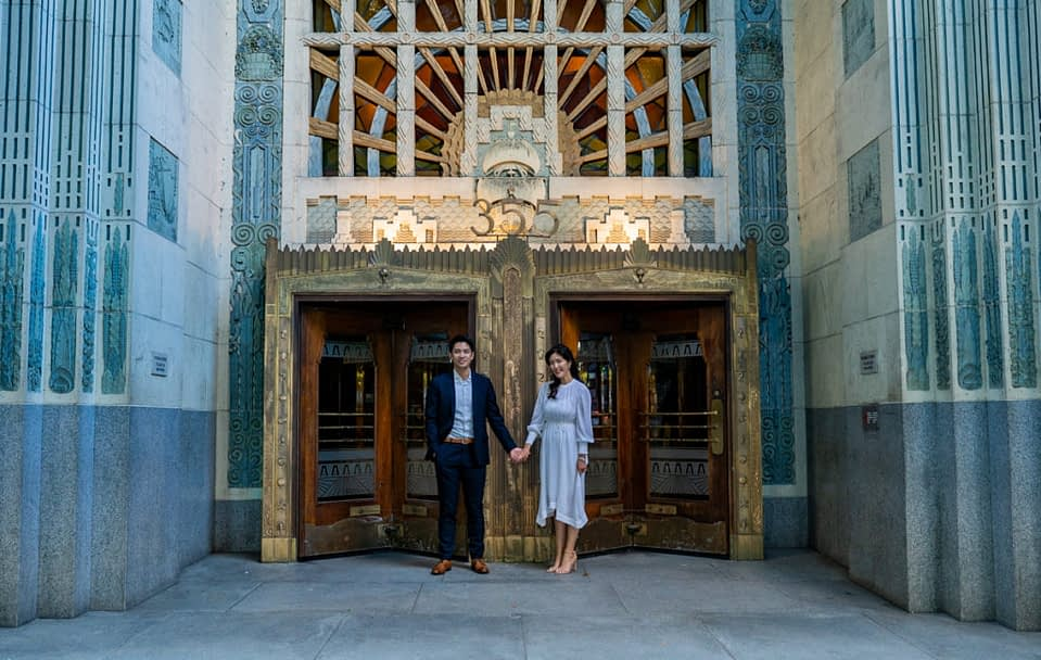 couple in front of the Marine building for their engagement session