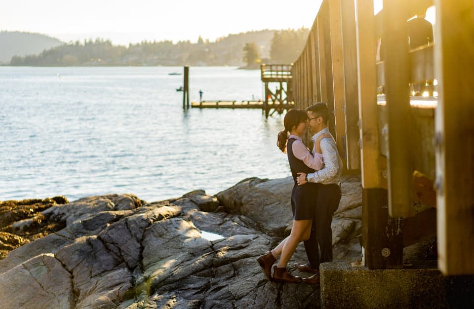Couple by the pier at Belcarra Park for their engagement photos