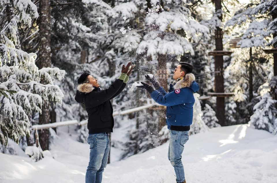 Gay couple throwing snow at Grouse Mountain