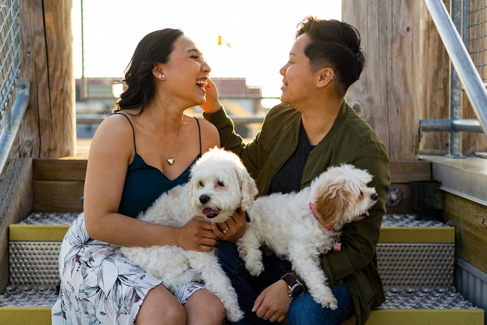 Lesbian engagement photo with two dogs