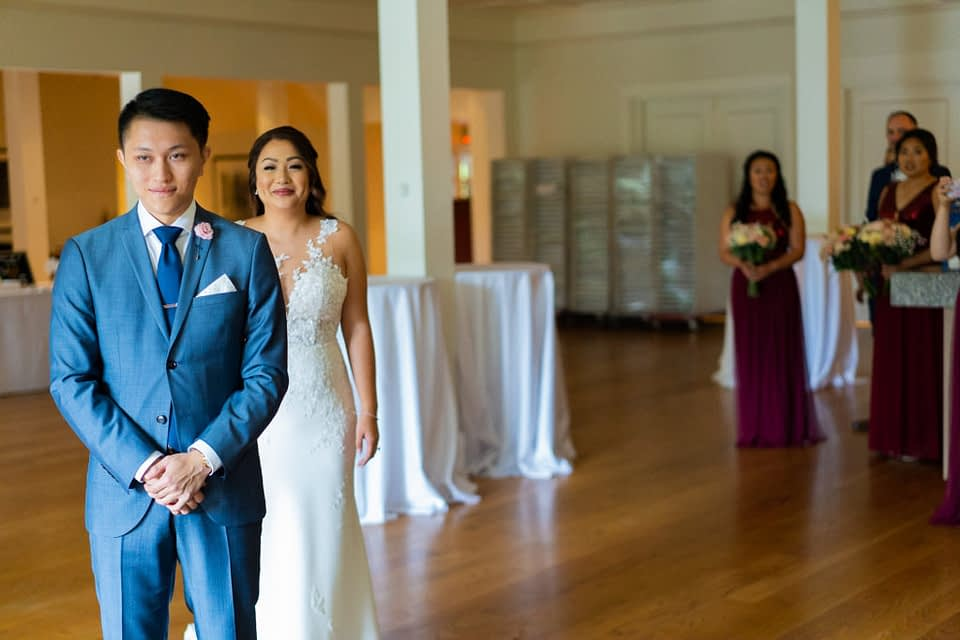 Bride walks towards his groom for the first look at Stanley Park Pavilion