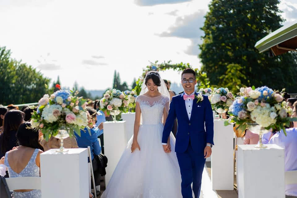 Bride and groom walking down during their Vancouver Golf Club ceremony