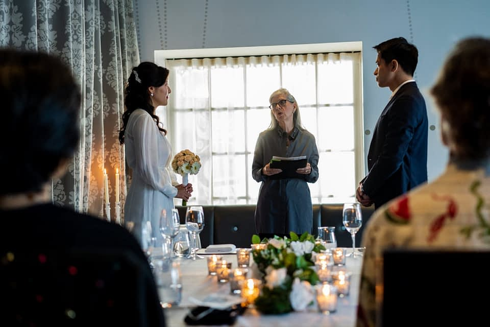 Verna a Vancouver wedding officiant at Bel Cafe during the ceremony