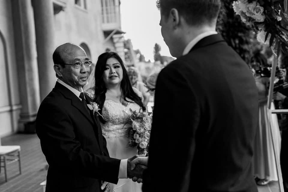 dad giving away the bride at Hycroft Manor wedding during the ceremony
