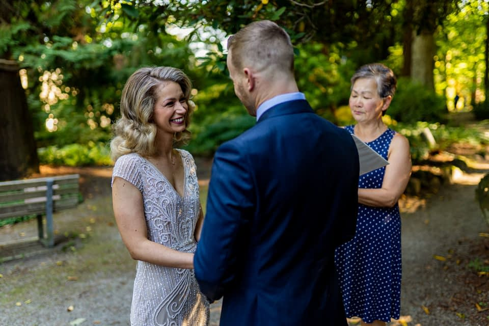 Bride sharing vows during Stanley Park elopement
